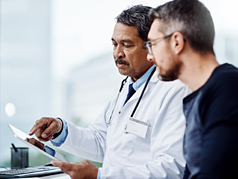 a health doctor talking to a patient about his results