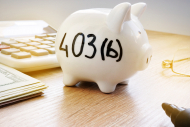 Piggy bank with sign 403b on a side.