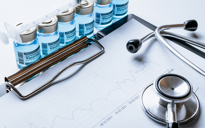 Statistics covid. Doctor stethoscope, hospital healthcare infographic charts and analytic medical statistics on hospital background. Global economy recovery after Covid 19 concept.